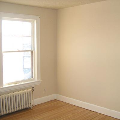 Spacious bedroom with beautiful hardwood